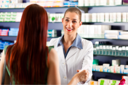 female pharmacist with a customer